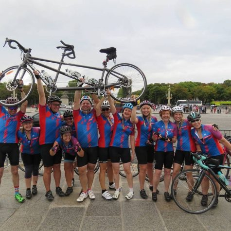 A group of cyclists celebrating in Paris