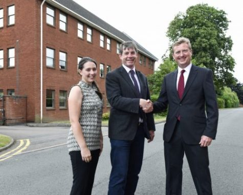 Partners shaking hands on office deal