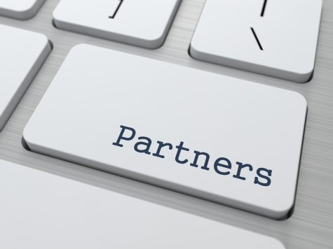 a keyboard key which says partner